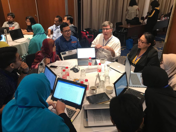 University of Indonesia scholars collaborating with University of Florida scholars at a workshop on academic writing and research design.