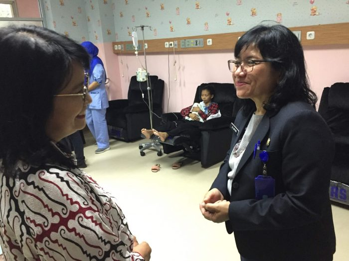 Luzi Adriyanti, Koja Hospital's vice director of maternal services, with Professor Asri Adissamita